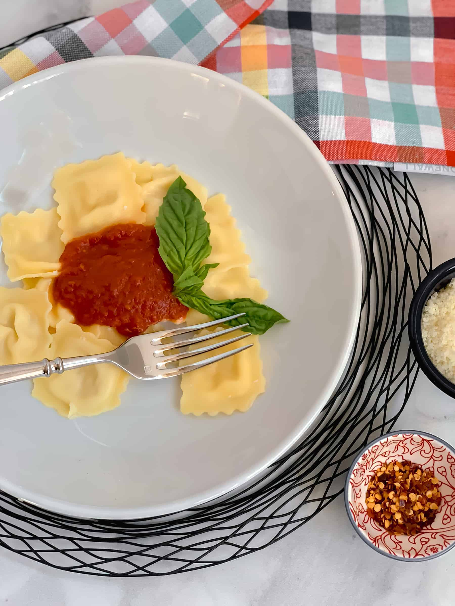 Ravioli with sauce on a white plate