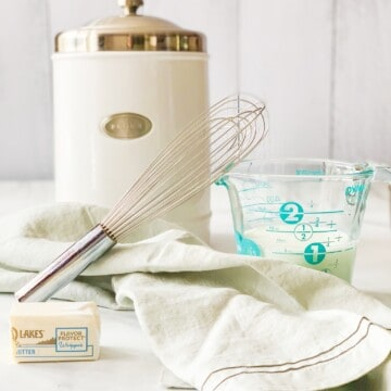 milk and flour container with whisk.