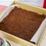 chocolate crust in a gold baking pan