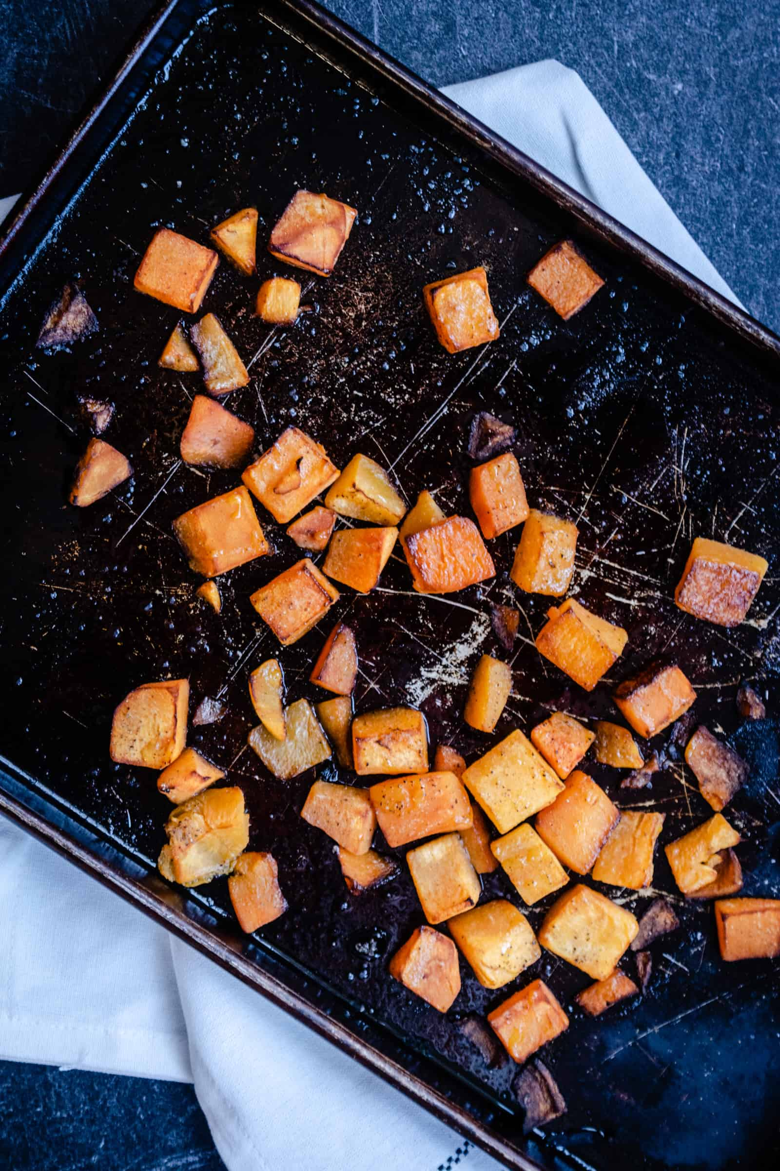 chopped roasted butternut squash on a baking sheet