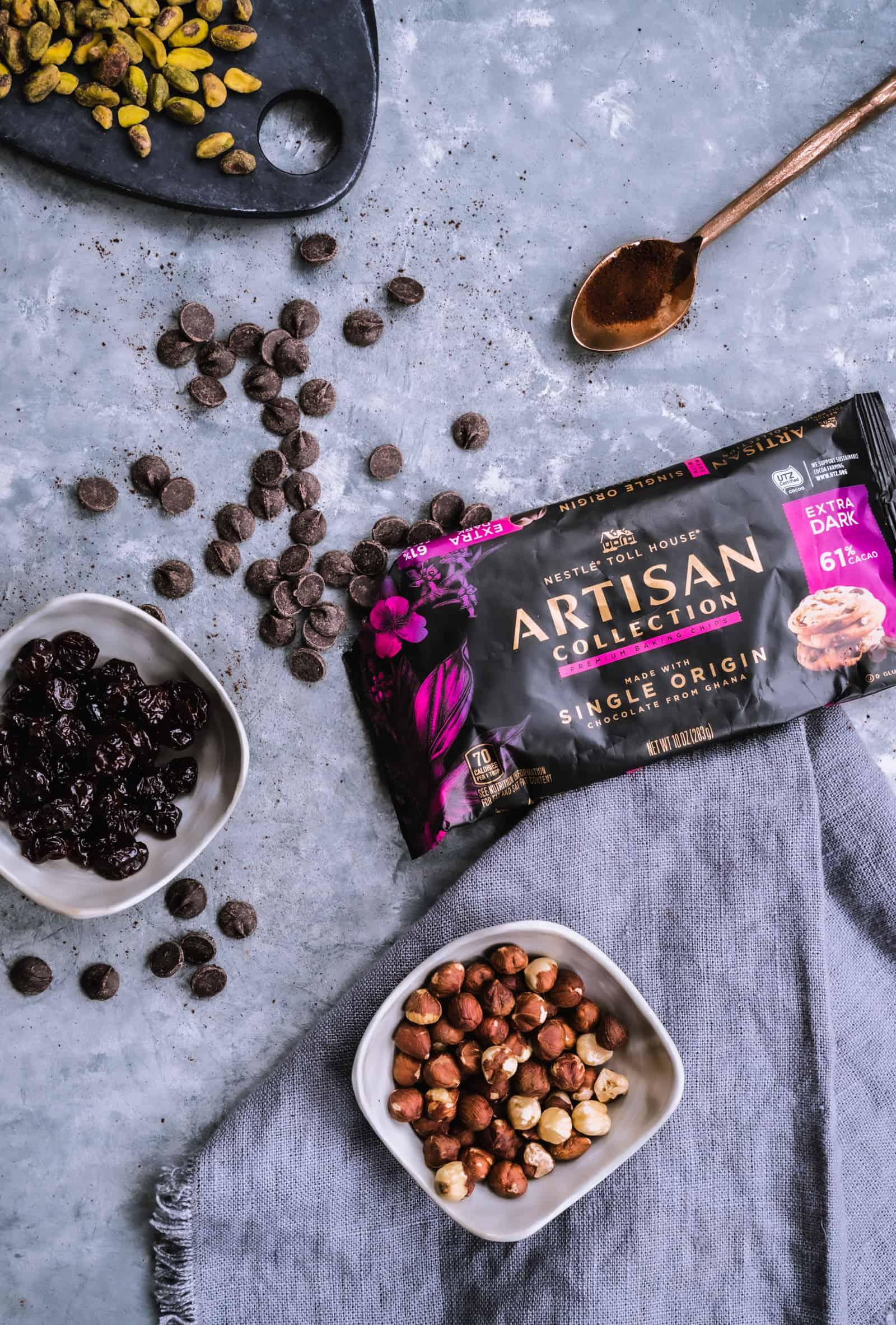 ingredients for dark chocolate bark with dried cherries, hazelnuts, espresso, and pistachios
