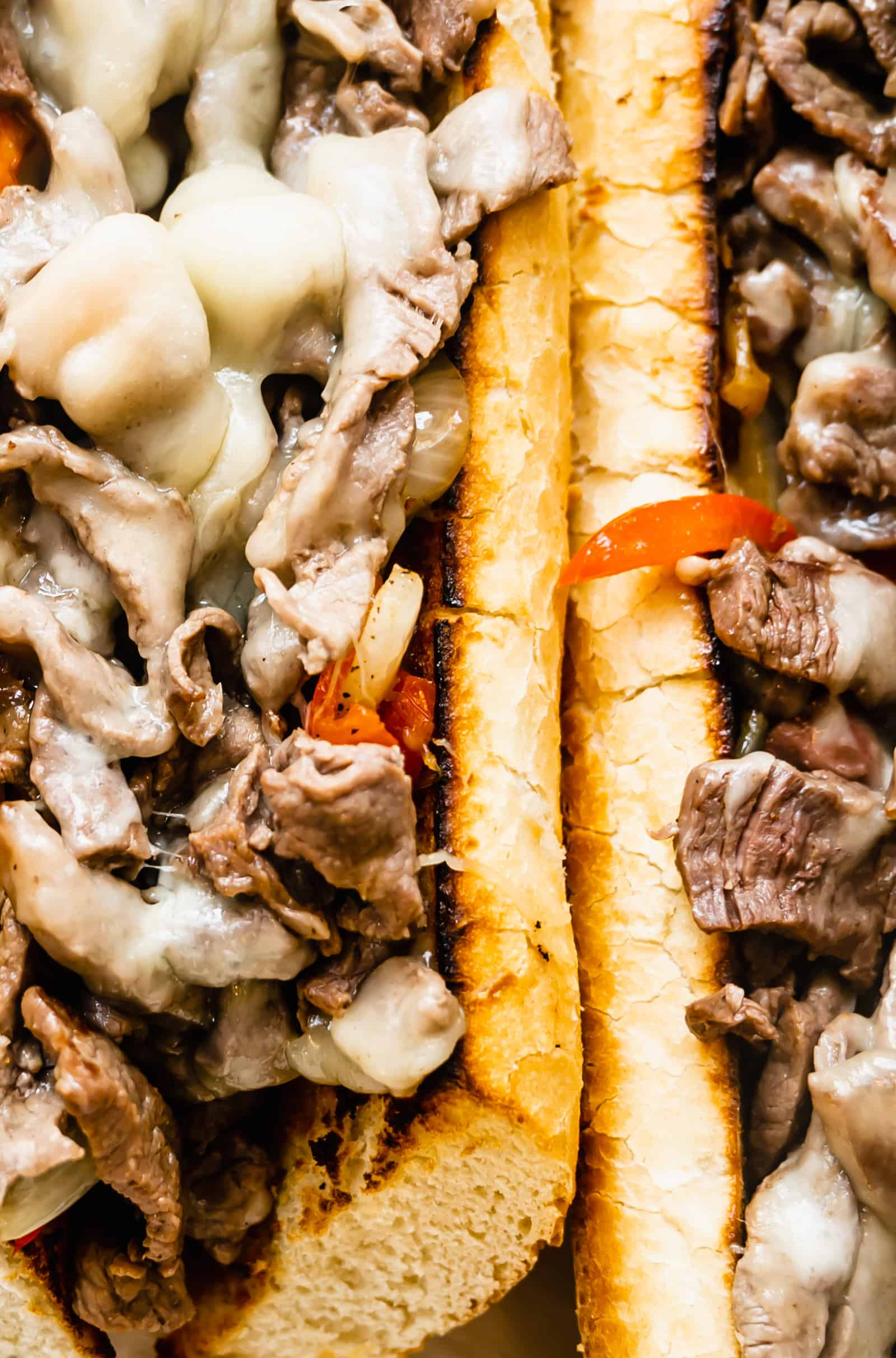 two vertical Philly Cheesesteak sandwiches zoomed in