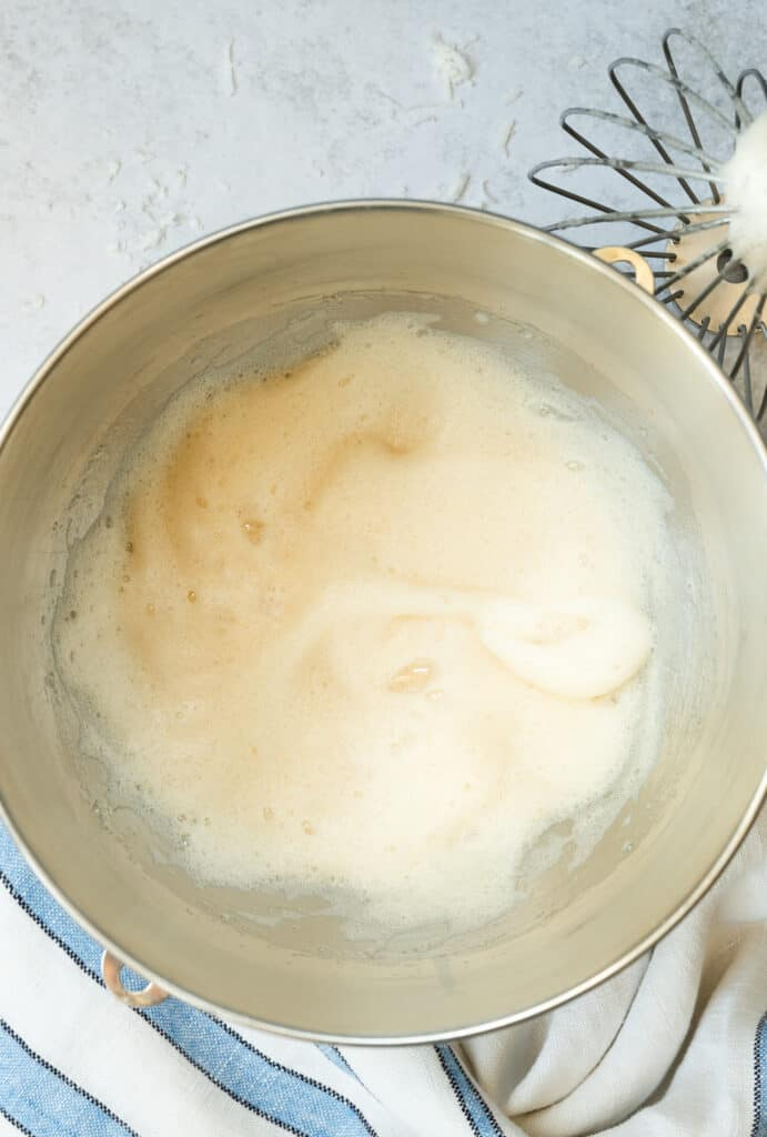mixing bowl of whipped egg whites and vanilla