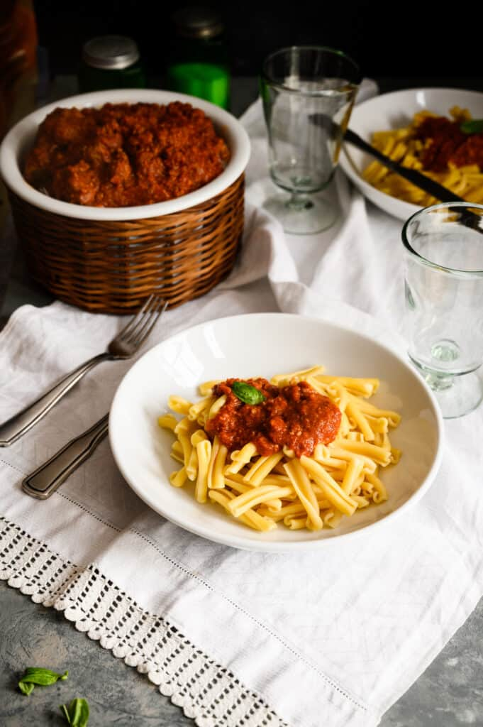 bowl of pasta with tomato sauce and bowl of meatballs