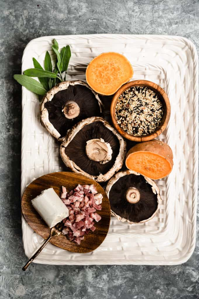 white platter with portobellos, two halves of sweet potato and diced pancetta