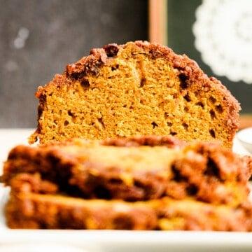 head on close up of cut loaf of pumpkin bread