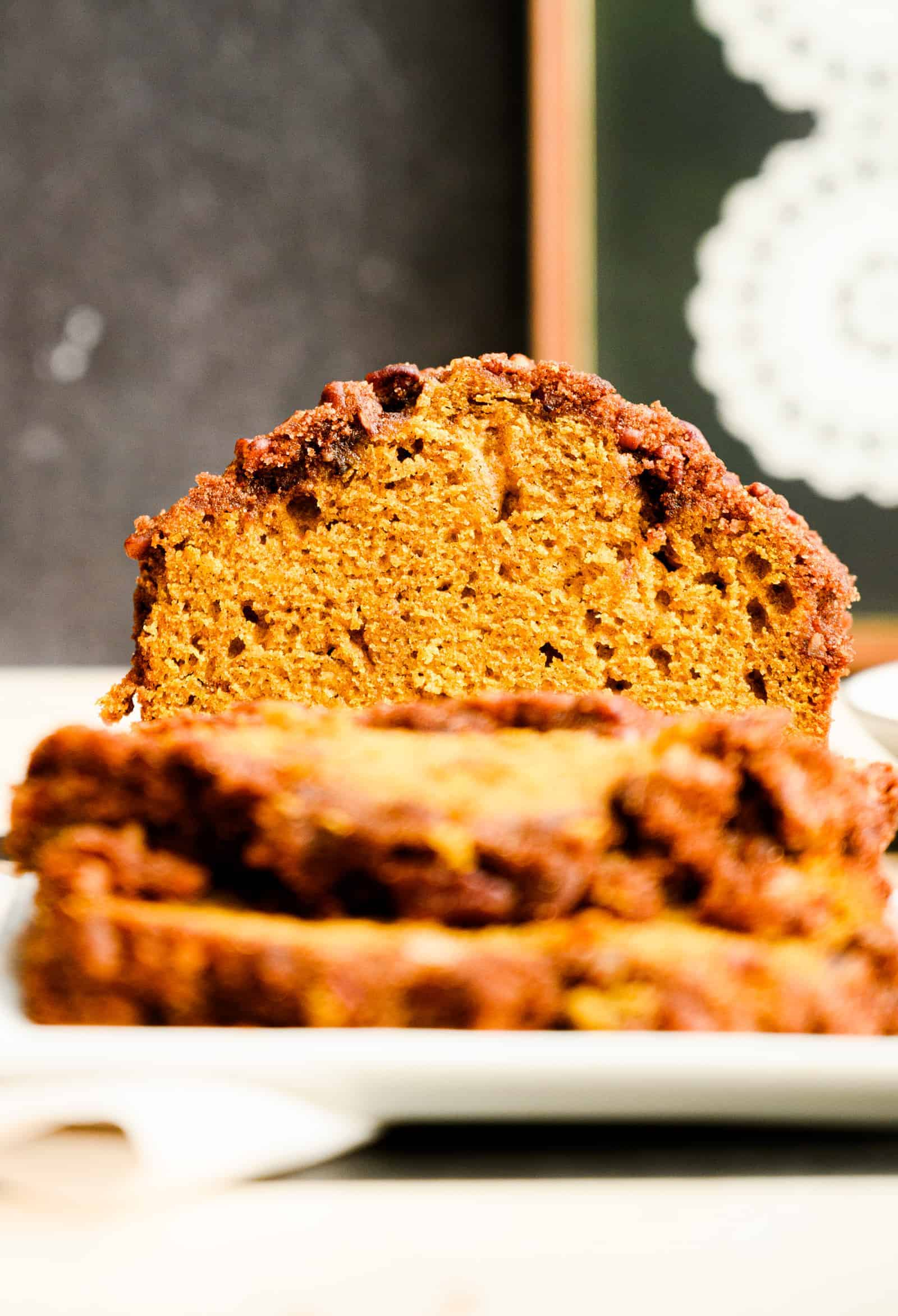 head on close up of cut loaf of pumpkin bread