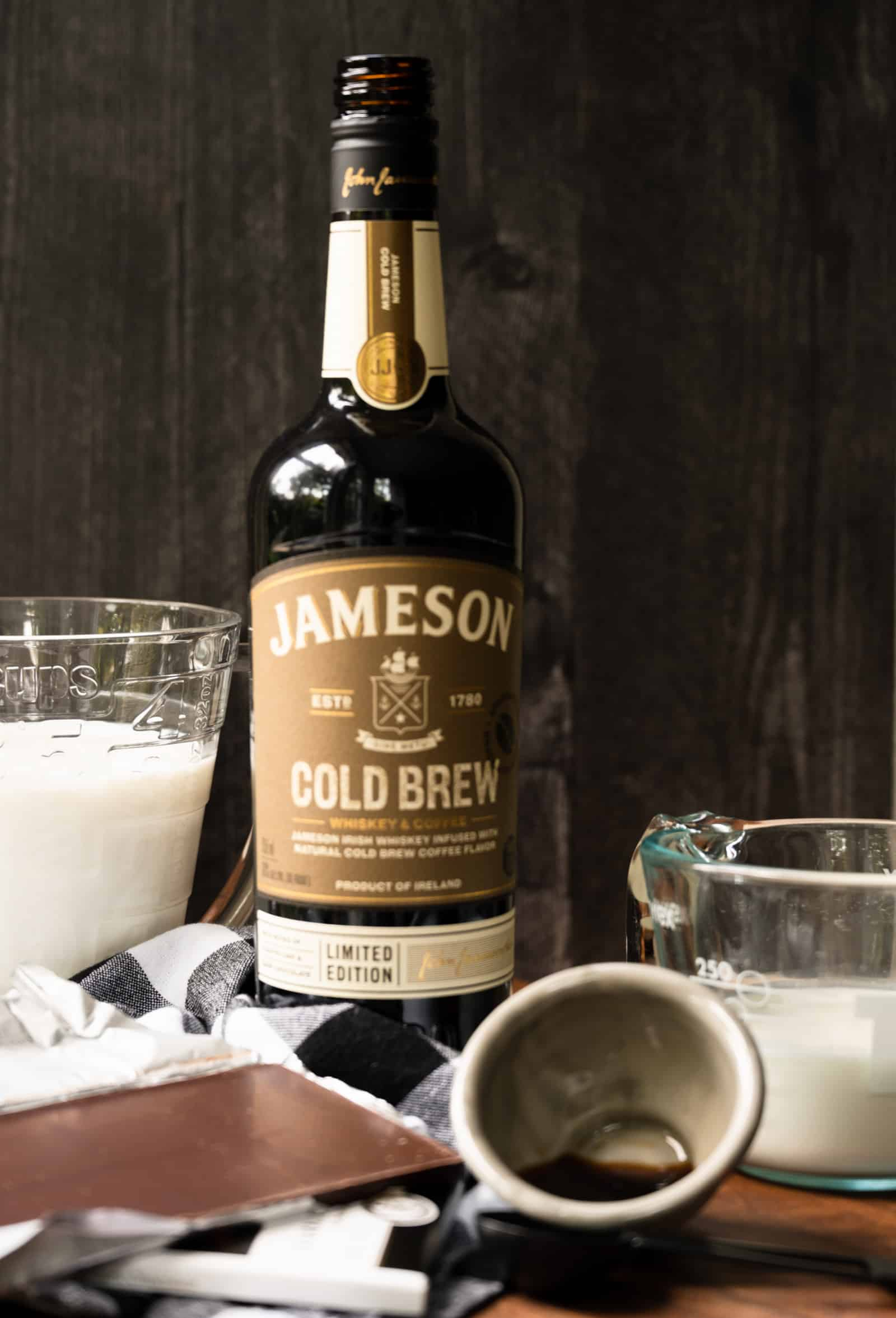 bottle of Jameson's Cold Brew with measuring cups of milk and chocolate