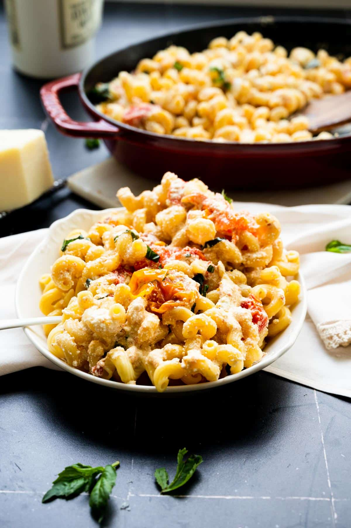 heaping portion of cavatappi pasta with tomatoes and goat cheese sauce