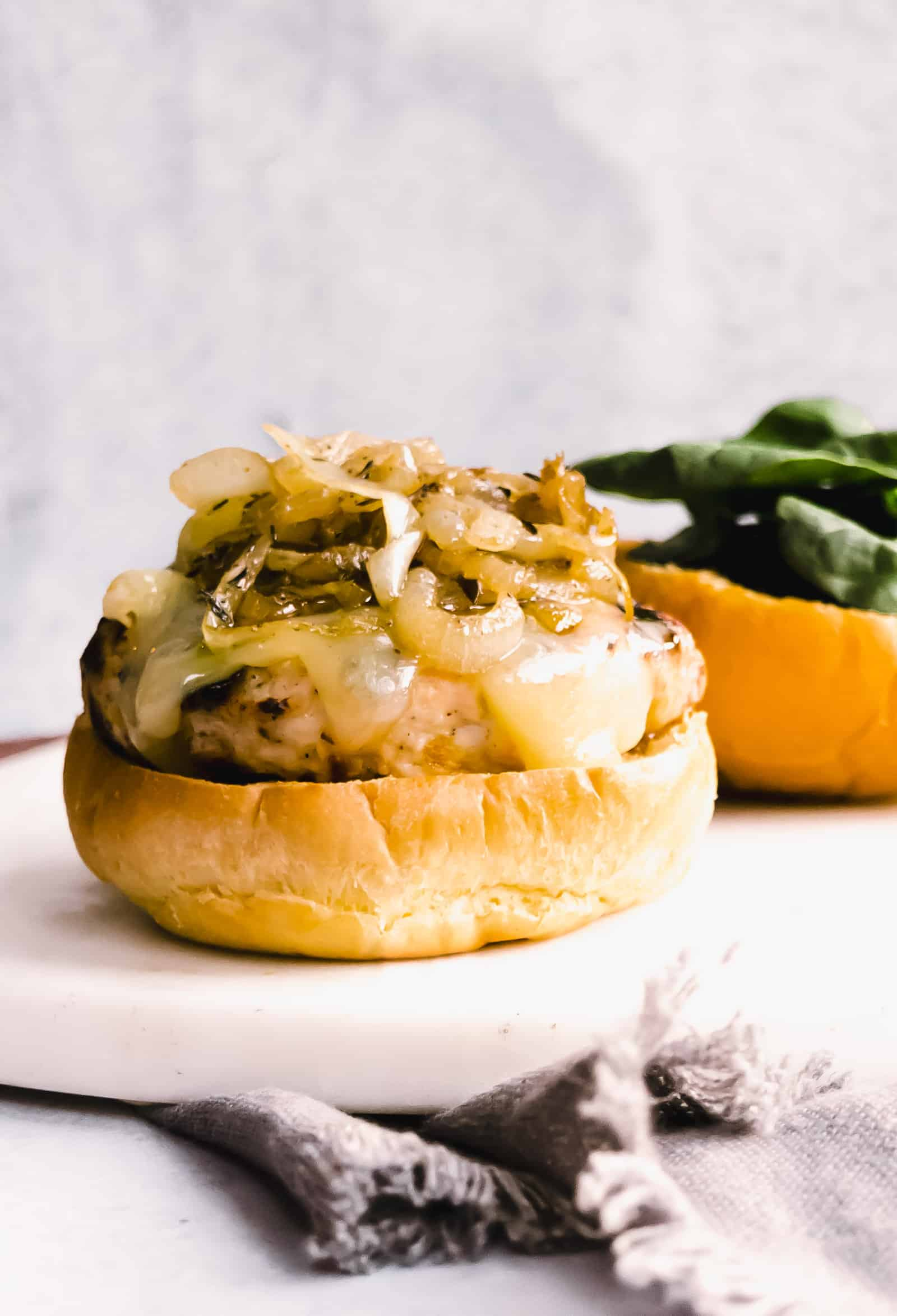 open-faced burger with caramelized onions on top