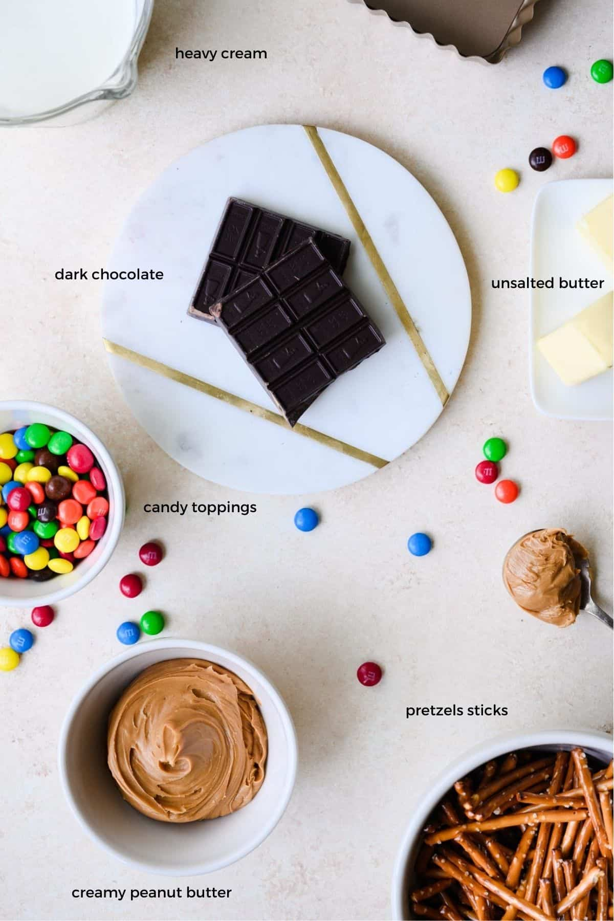 ingredients needed to make a peanut butter chocolate tart with pretzel crust