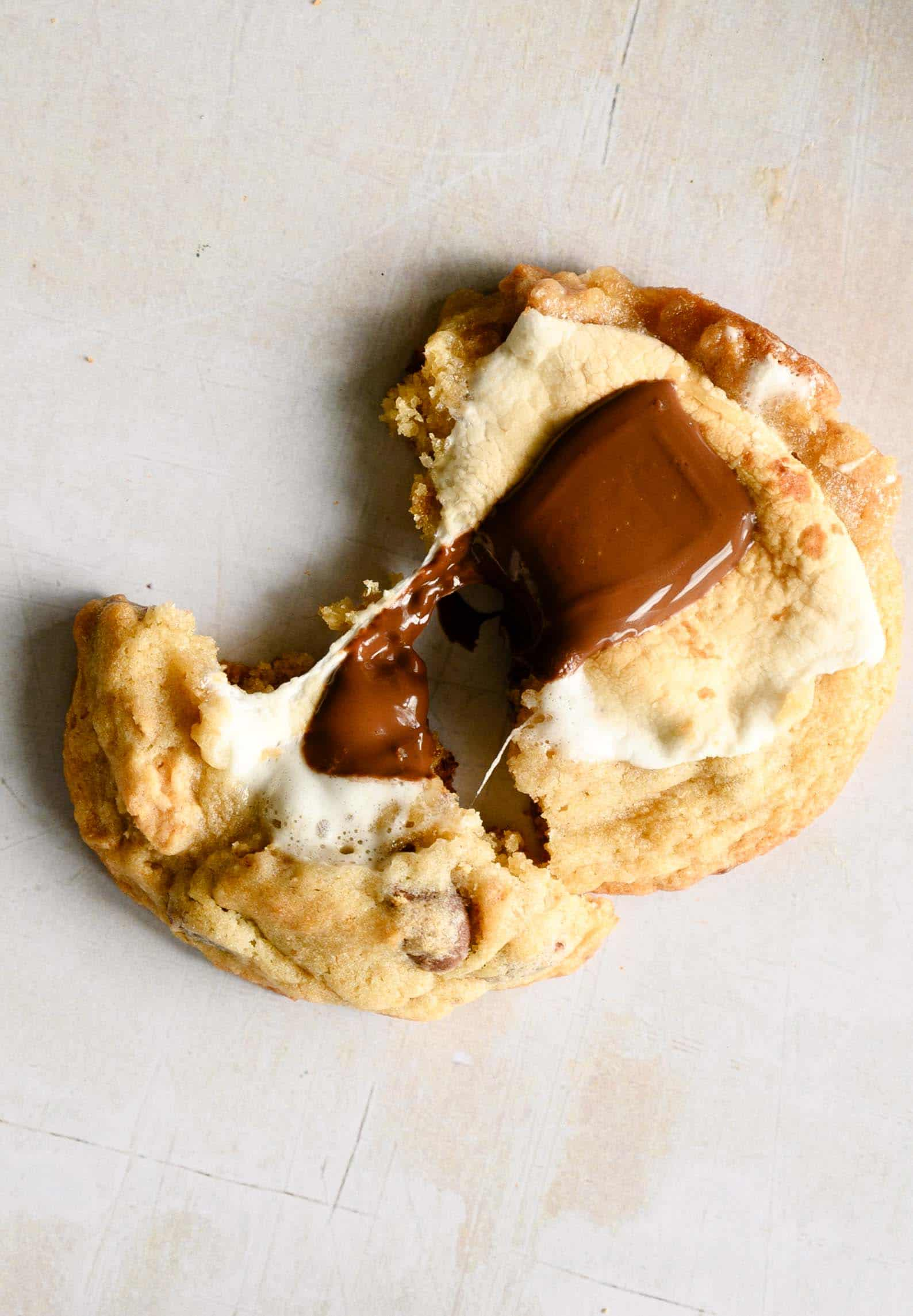 a chocolate and marshmallow covered chocolate chip cookie with a bite out of it
