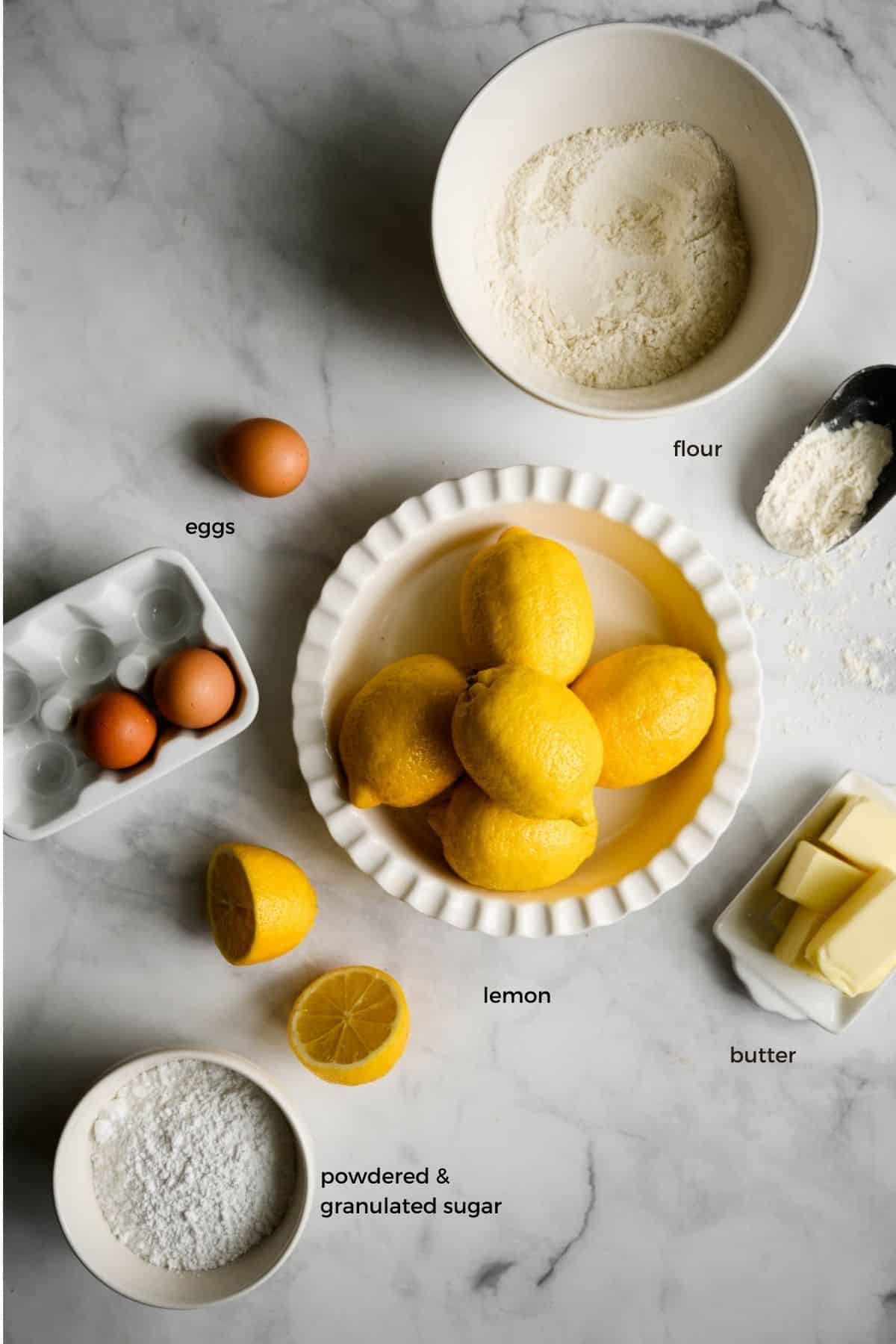 ingredients including flour, powdered sugar, eggs, lemons and butter.